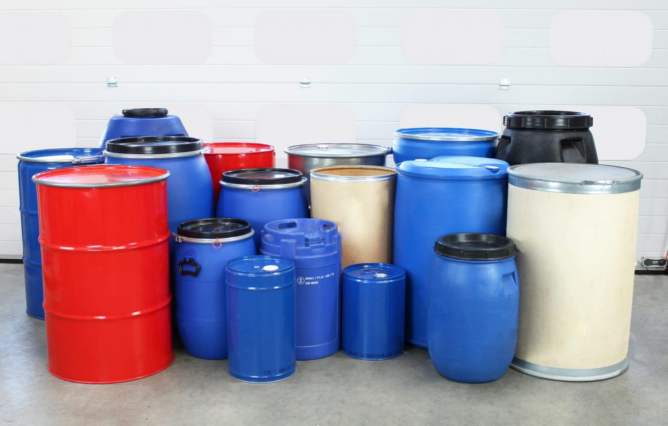 A range of different drums for industrial material handling on the STS warehouse floor.