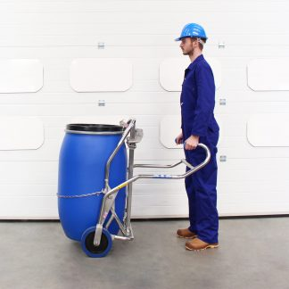 A man uses the STS Universal Drum Trolley to manually handle a drum.