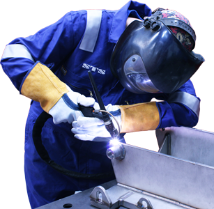 An STS engineer welds a piece of manual handling equipment.