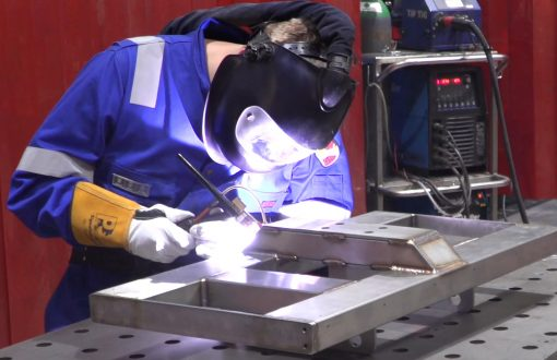 A coded welder fabricates using 304 grade stainless steel.