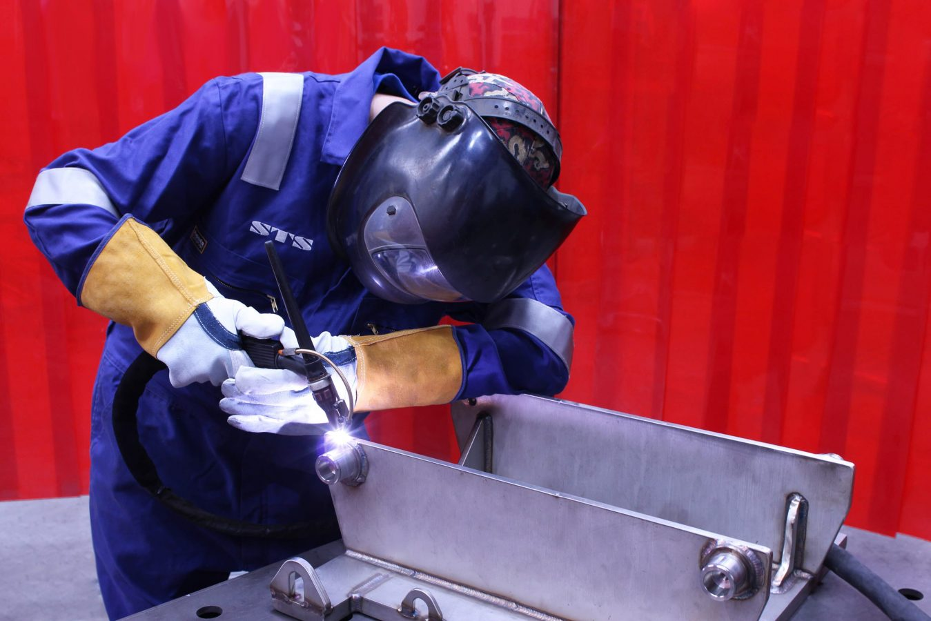 An engineer welds an STS unit at the manual handling equipment manufacturer's factory.