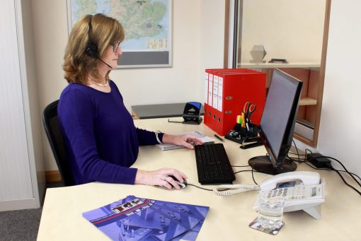 An STS employee works at her desk in the manual handling equipment manufacturer's sales office.