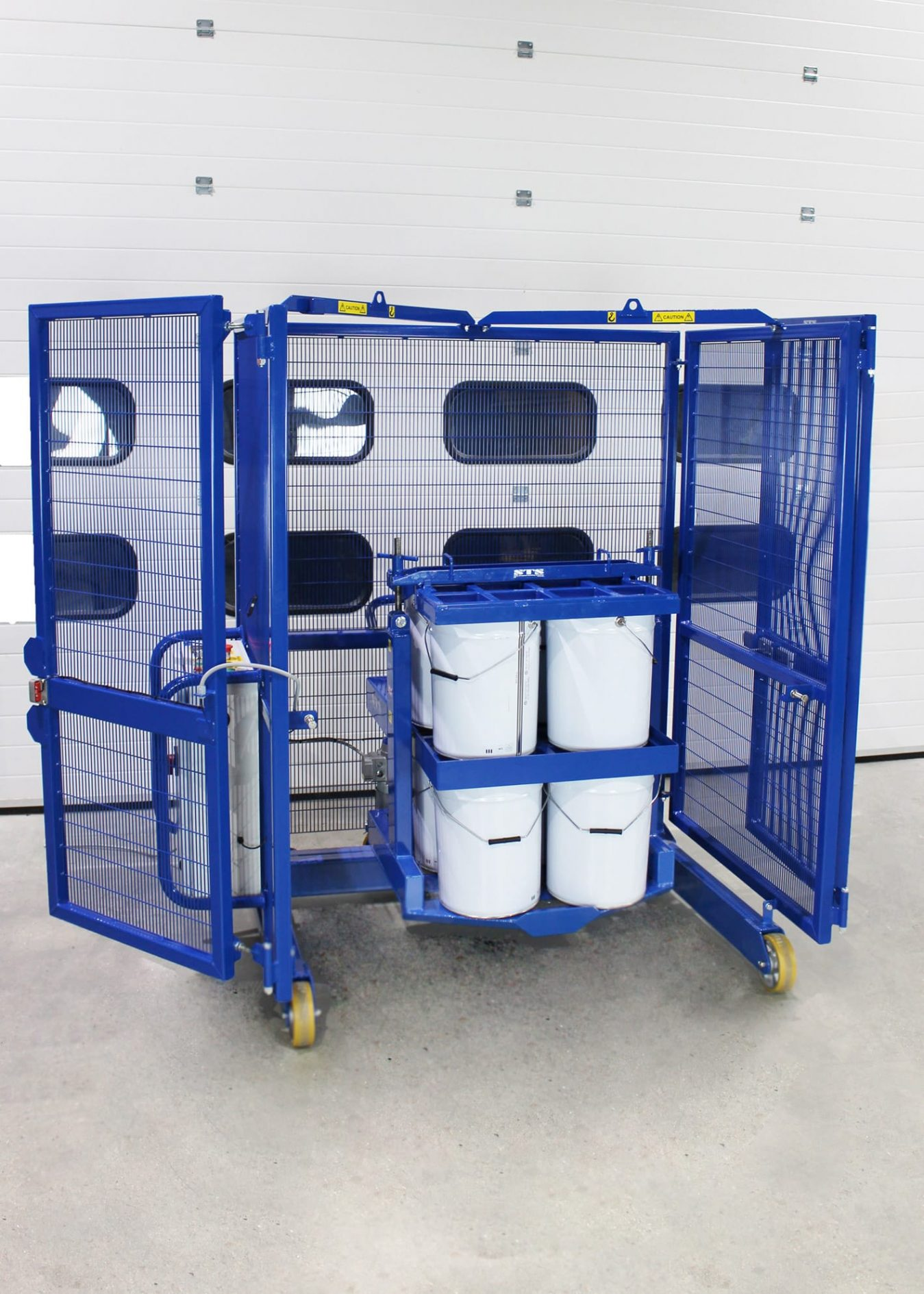 A paint drum mixer by STS with the mixing cage doors open.