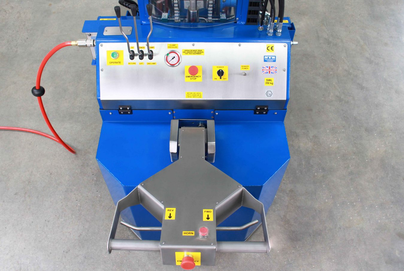 Pneumatic controls features emergency stop and powered lift to rotate and clamp drums