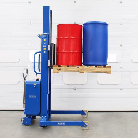 A bespoke pedestrian stacker with raised forks supporting palletised drums