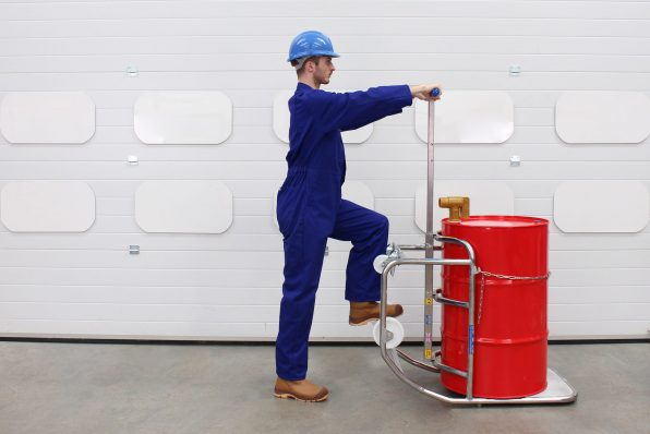 An engineer secures the drum into the STS drum dispenser