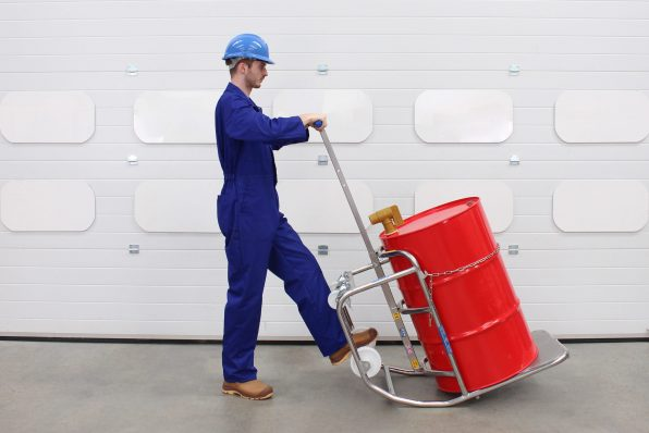 An operator manually tilts the STS drum dispenser