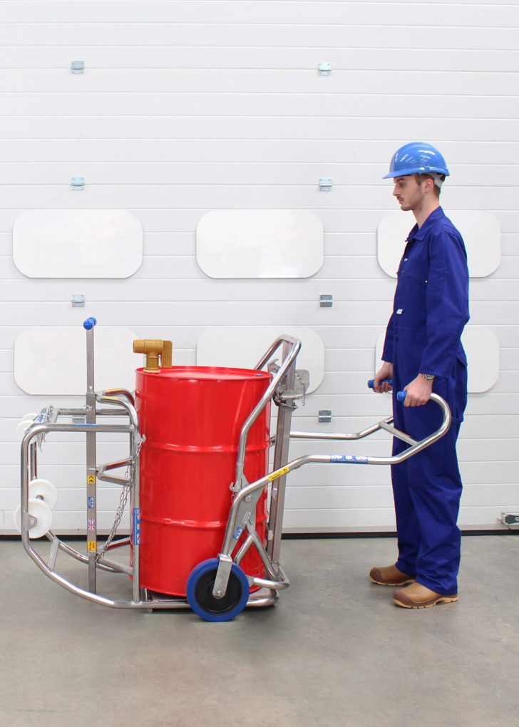 An operator uses our drum trolleys to load the drum dispenser