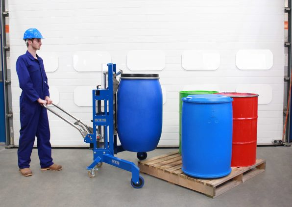 An operator using an STS Corner Drum Depalletiser to lift drums and barrels off of a pallet