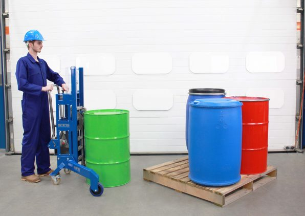Operator handles a 220 litre steel drum with the corner drum lifter