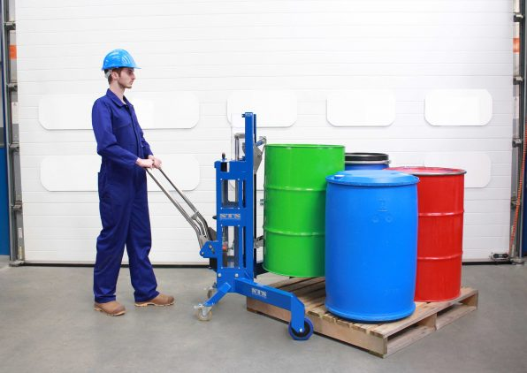 An operator uses an STS drum lift depalletiser for manual handling a range of drums