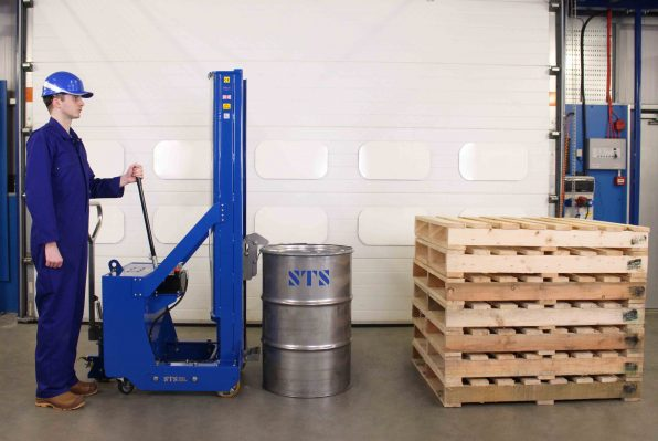 Operator approaches steel drum with the tall counterbalance drum stacker.