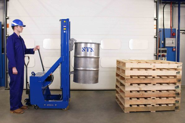 Operator lifts steel open top drum with the tall counterbalance drum lifter.