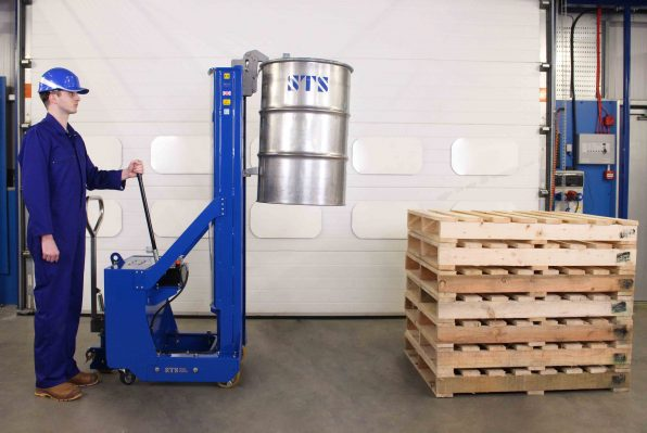Operator raises drum to height with the counterbalance drum stacker.