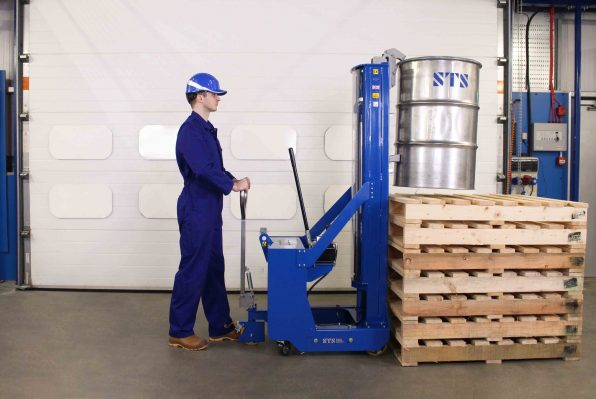 Operator approaches raised platform with the counterbalance drum stacker.