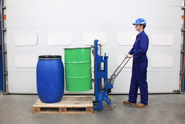 A Euro Pallet Hydraulic Drum Lifter lifts a 200litre steel drum on a pallet