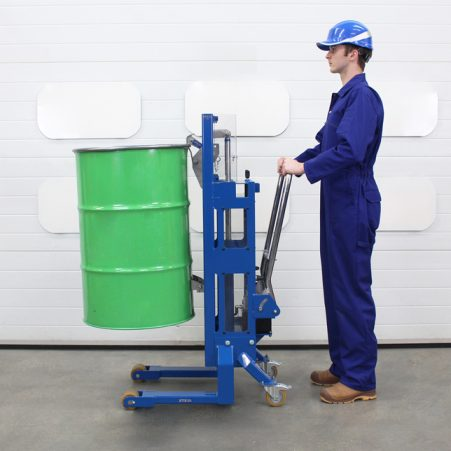 Operator lifts a 200 litre steel drum of water using the Euro Pallet Drum Lifter