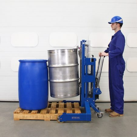 Operator approaches a drum with a hydraulic drum handler and picks it up.