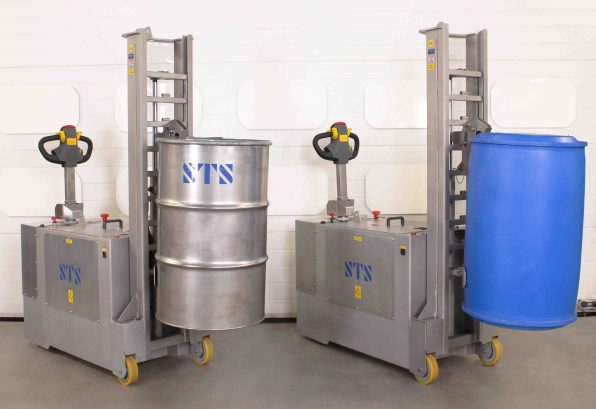 Two stainless steel drum handlers hold 350kg 205 litre drums at height.