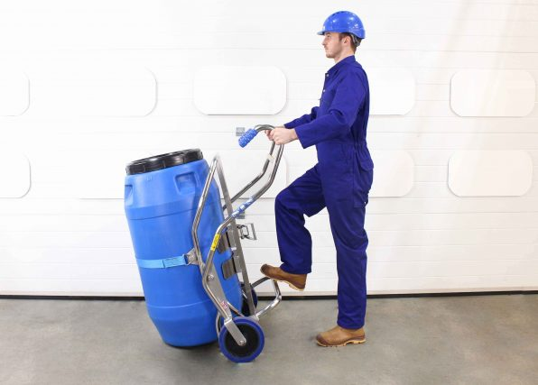 Operator uses a barrel trolley holding a 200litre screw top plastic drum.