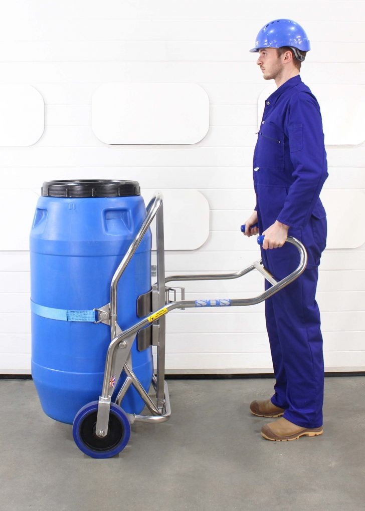Operator using a barrel trolley to move barrels of up to 350kg