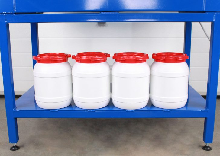 Cabinet with drum rollers, for handling four small drums as shown.