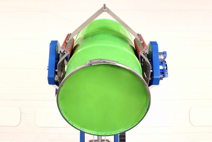 power clamp drum rotator holding a 200 litre open top drum