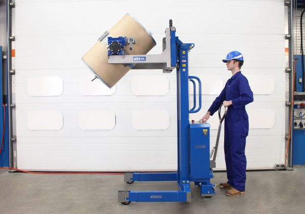 An operator using the ATEX drum tipper to lift a drum into the vertical orientation
