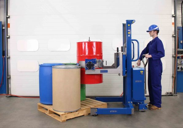 An operator uses the ATEX Pneumatic Drum tipper to rotate a drum into the decanting position
