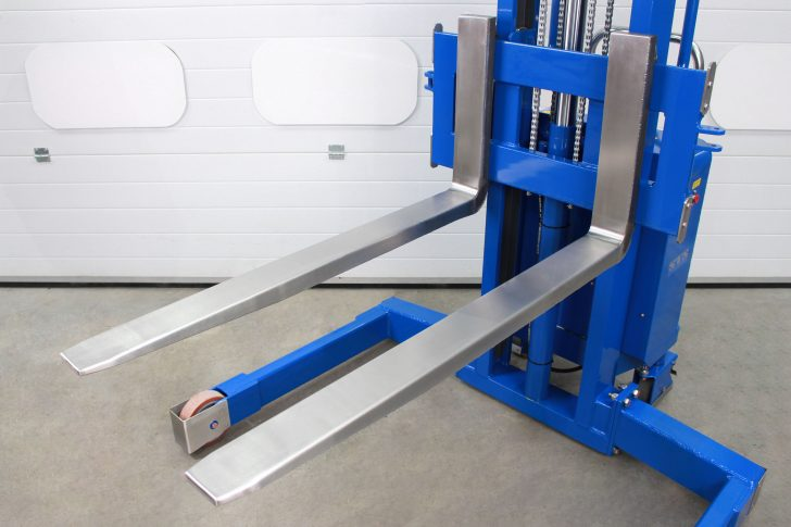 Close-up of the stainless steel forks on an ATEX straddle stacker.