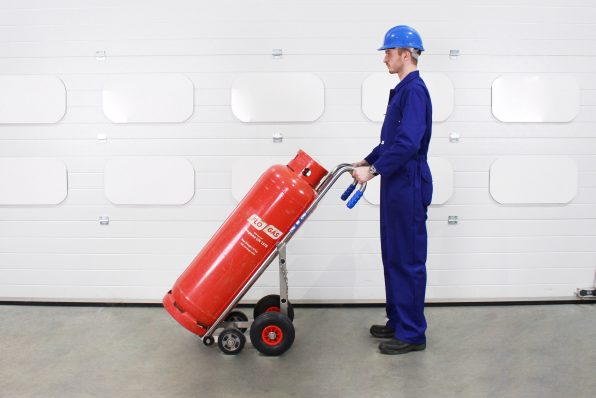 Operator moving an LPG cylinder in an STS gas truck..