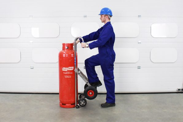 Preparing to pull the propane cylinder and LPG trolley back onto the units' wheels.