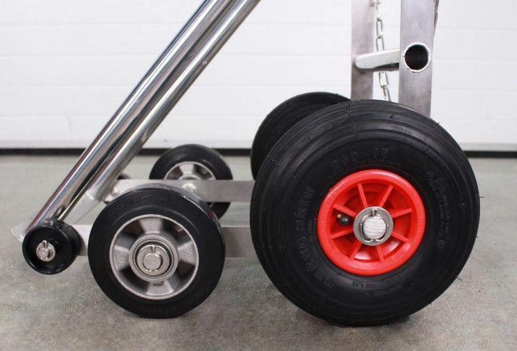 Closeup of LPG cylinder trolley pneumatic wheels.