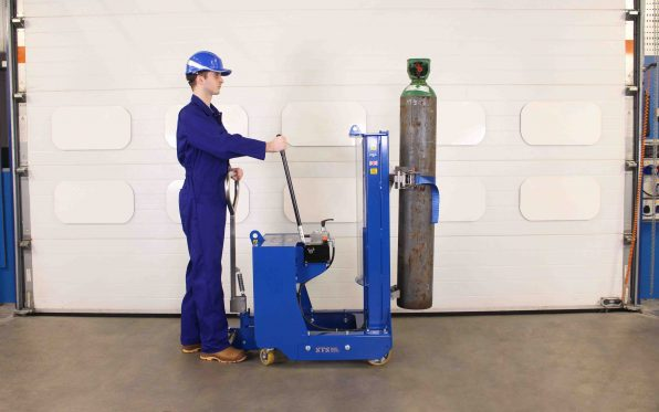 Operator pumps the manual-hydraulic hand pump on the gas cylinder lifter.