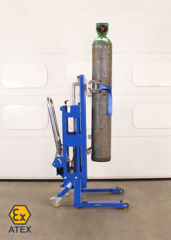 Gas bottle lifter holds a bottle at height in a zoned hazardous area.