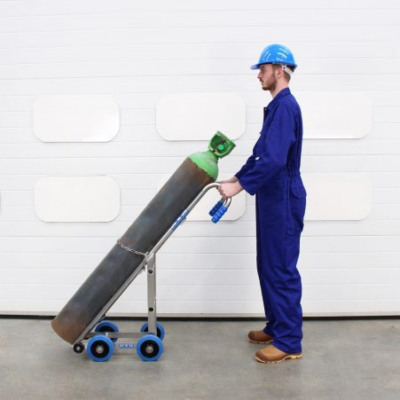 An engineer uses a trolley for gas cylinder handling