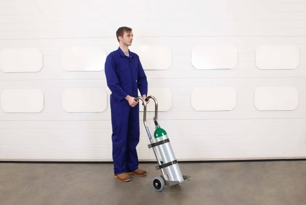 Operator uses the medical gas cylinder trolley to manoeuvre a gas bottle around a hospital