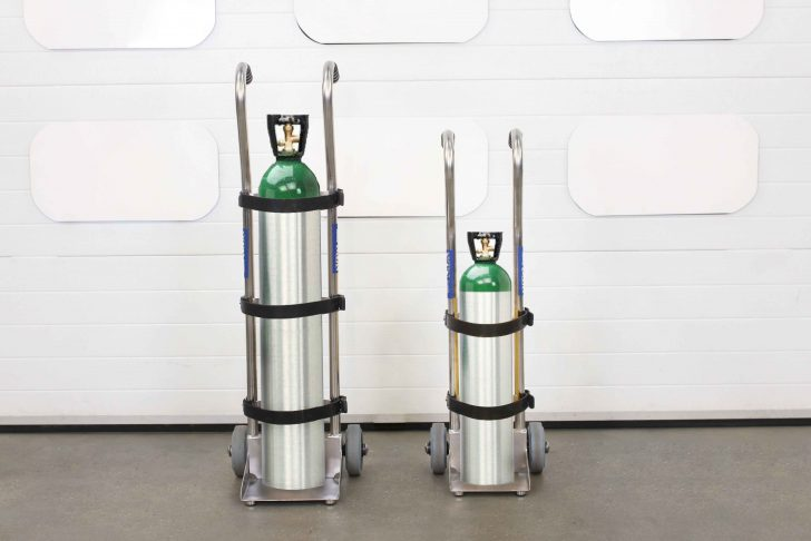 A medical gas cylinder trolley with two different size gas cylinders.