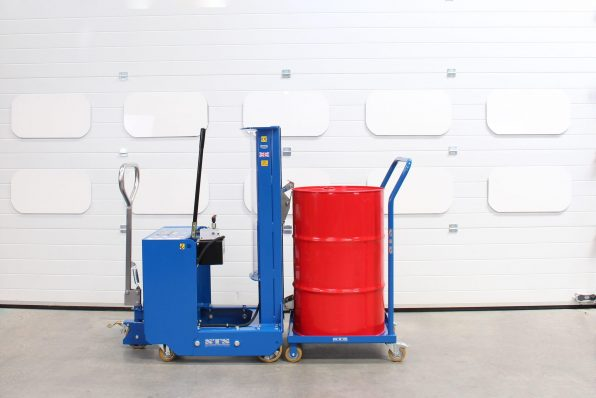 An STS drum lifter beside a loaded oil drum dolly with handle.