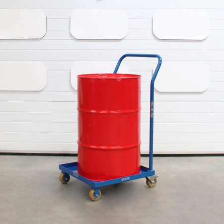 A steel drum loaded onto the base plate of a oil drum dolly